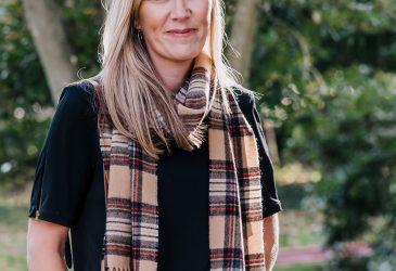 Glencroft camel stewart beige tartan lambswool scarf on female model