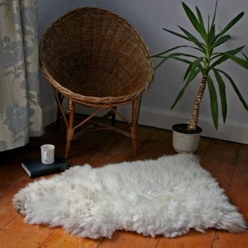 Natural white Glencroft British sheepskin rug on the floor