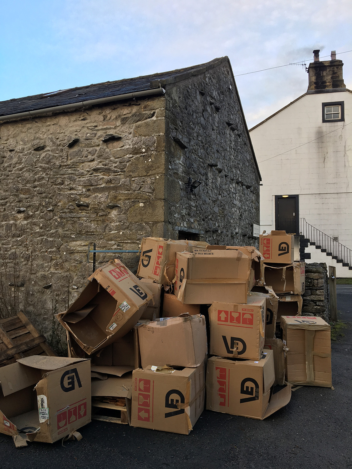 Cardboard boxes piled up outside warehouse