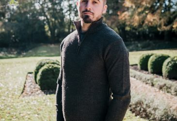 Green zip neck wool jumper on model
