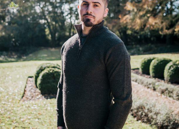 Green zip neck wool jumper on model