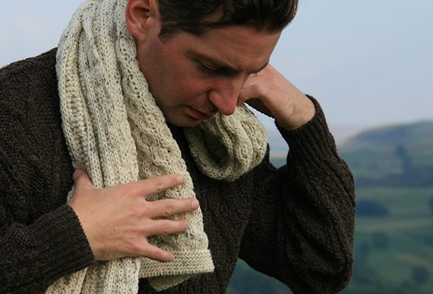 Knitted aran scarf on model