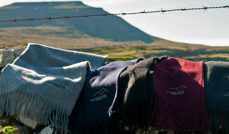 Glencroft 3 peaks scarves in front of Ingleborough mountain
