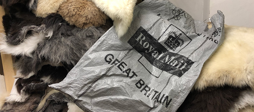 Royal Mail posting sack on some sheepskin rugs