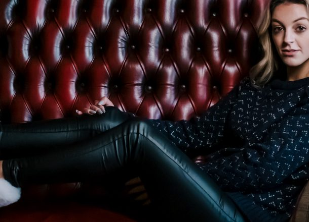 Model in tweed slippers on leather sofa