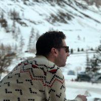 Model wearing chevron ski merino wool jumper in snow