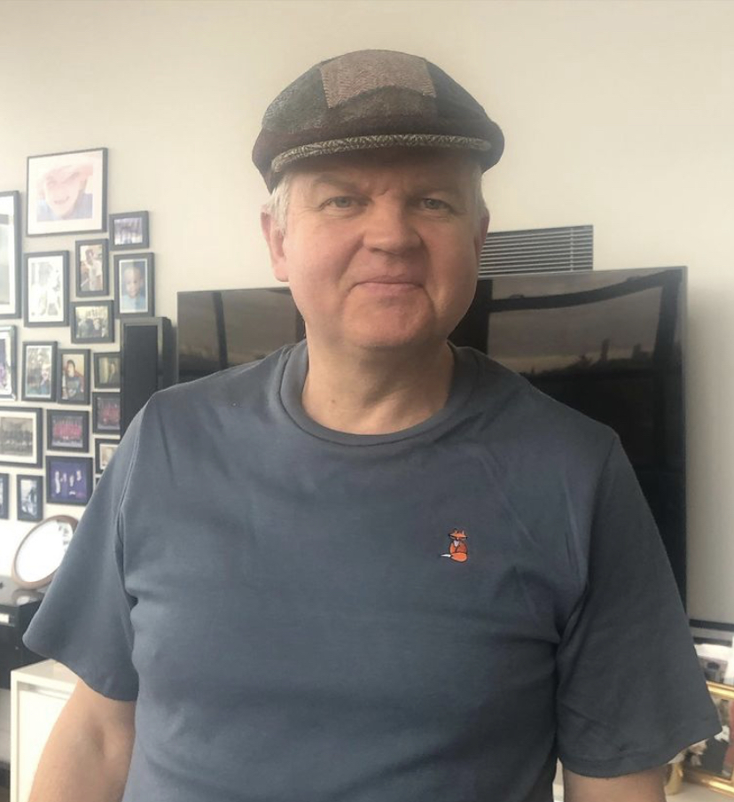 Adrian Chiles in a flat cap
